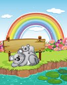 Two bears near the empty signboard with a rainbow in the sky