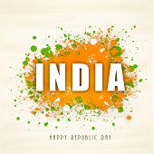 India text on national tricolor splash background for Happy Indian Republic Day celebration.