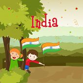 Cute little kids holding national flag and enjoying on occasion of Indian Republic Day and Independence Day on nature view background.
