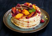 Pancakes With Fruit, Berries, Mint And Cinnamon