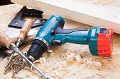 Drill With Timber, Screwdrivers And Screws