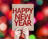 Happy New Year card written on colorful background with defocused lights
