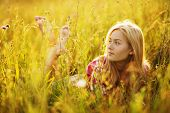 stock photo of beatitudes  - Happy barefoot girl in a field of grass and flowers - JPG