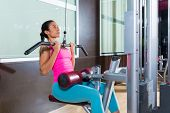 stock photo of lats  - Cable Lat pulldown machine woman workout at gym exercise - JPG