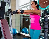dumbbell front shoulder flies fly woman workout exercise at gym