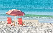 picture of gulf mexico  - Pink umbrella and lounge chairs on the Miramar Beach in Destin Florida - JPG