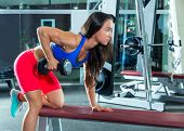dumbbell triceps kickback girl workout exercise at gym