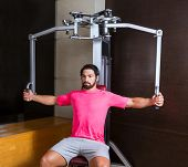 pec-deck fly flies pec deck chest workout man exercise at gym