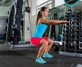 image of squatting  - Air squat woman workout exercise at gym - JPG