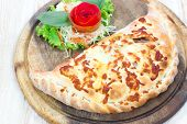 Close Up Italian Pizza Calzone On Wood Table