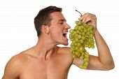 Young man with grapes