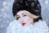 Winter Woman in Luxury Fur Coat. Beauty Fashion Model Girl. Beautiful winter girl in winter knitted