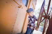 foto of caboose  - Cute Young Mixed Race Boy Having Fun Outside on Railroad Car - JPG