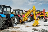 Excavators demonstration on exhibition. Russia