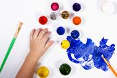 Children Hands Painted With A Brush On Paper