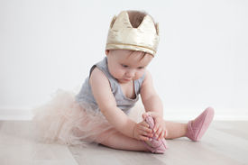 stock photo of toddlers tiaras  - Stylish little baby posing in princess attire - JPG