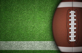 stock photo of balls  - American football ball on green grass and white line - JPG