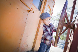 image of caboose  - Cute Young Mixed Race Boy Having Fun Outside on Railroad Car - JPG