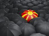 foto of macedonia  - Umbrella with flag of macedonia over black umbrellas - JPG