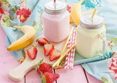 picture of banana  - Vintage glass jars with milk and fresh strawberries and bananas - JPG