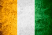 image of ivory  - flag of Ivory Coast or banner on rough pattern texture background - JPG