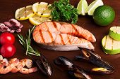 image of salmon steak  - Grilled salmon steak with vegetables and seafood - JPG