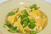 stock photo of cilantro  - Homemade lemongrass chicken dumplings garnished with cilantro - JPG