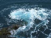 foto of breaker  - The rocks and the wave breakers of the Atlantic ocean at Puerto de la Pena on the island Fuerteventura one of the Canary islands belonging to Spain - JPG