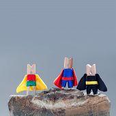 stock photo of superhero  - Superheroes on the rock - JPG