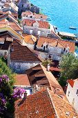 foto of red roof tile  - View from the top of the red tile roofs and the sea - JPG