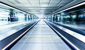 image of escalator  - symmetric moving blue escalator inside contemporary airport - JPG
