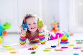 pic of education  - Child playing with wooden toys at preschool - JPG