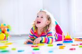 stock photo of kindergarten  - Child playing with wooden toys at preschool - JPG