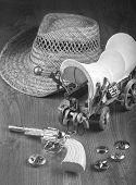 picture of gunslinger  - Little boys cowboy toys in black and white - JPG