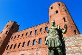 stock photo of torino  - Roman statue of Julius Caesar and ancient ruins of Palatine Towers in Torino Piemonte Italy - JPG