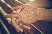 stock photo of 70-year-old  - old hands of a female elderly with freckle and wrinkles - JPG