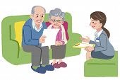 image of geriatric  - Elderly couple consults with Geriatric care manager or travel agent - JPG