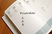 foto of priorities  - Priorities Concept Business Notepad on wooden table - JPG