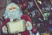 foto of accordion  - Christmas santa toy playing the accordion vintage photo effect background - JPG