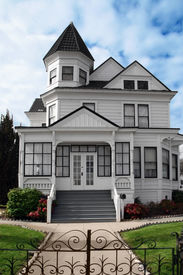 stock photo of victorian houses  - beautiful victorian white house with a lawn in front - JPG
