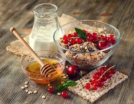 stock photo of whole-grain  - Healthy breakfast with muesli or granola milk fresh berries red currant whole - JPG