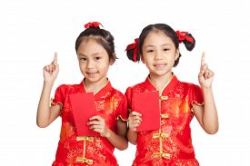 image of identical twin girls  - Asian twins girls in chinese cheongsam dress with red envelopes isolated on white background - JPG