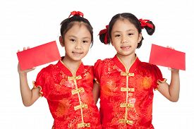picture of identical twin girls  - Asian twins girls in chinese cheongsam dress with red envelopes isolated on white background - JPG