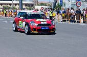VALENCIA, SPAIN - MAY 16: To promote the Mini Challenge 2010 event, a Mini Cooper gives a demo in the streets of Valencia with the female driver Marta Suria on May 16, 2010 in Valencia, Spain.