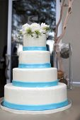 blue and white tiered wedding cake