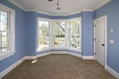 stock photo of baseboard  - blue bedroom with lots of windows looking out onto pond - JPG
