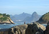 Fishing On The Beach, With Christ Redeemer Statue, One Of The New Seven Wonders Of The World, In The
