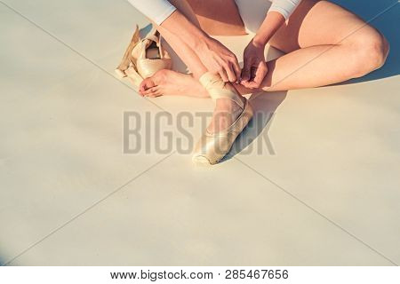 poster of Dancing On Pointe. Ballerina Shoes. Ballerina Legs In White Ballet Shoes. Lacing Ballet Slippers. Fe