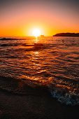 Orange Teal Sunset On A Beautiful Beach. Beautiful Vivid Sunset Over Beach With The Water Vivid. A B poster