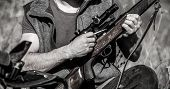 Hunter Man. Hunting Period. Male With A Gun, Rifle. Man Is Charging A Hunting Rifle. Close Up. Proce poster